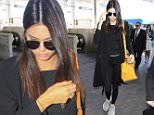 Kendall Jenner arrives at LAX before her long flight to join family in the South of France. June 25, 2015 X17online.com
