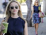 24.JUNE. 2015 - SANTA MONICA - USA \nAMERICAN ACTRESS REESE WITHERSPOON IS SEEN PICKING UP A JUICE WHILE OUT AND ABOUT IN SANTA MONICA, CALIFORNIA.\nREESE LOOKED SMART IN A BLUE FLORAL PENCIL SKIRT AND COORDINATING PINK SHOES AND HANDBAG, WHICH HAD HER INITIALS 'RW ON.'\nBYLINE MUST READ : XPOSUREPHOTOS.COM\n***UK CLIENTS - PICTURES CONTAINING CHILDREN PLEASE PIXELATE FACE PRIOR TO PUBLICATION ***\nUK CLIENTS MUST CALL PRIOR TO TV OR ONLINE USAGE PLEASE TELEPHONE 0208 344 2007**