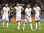 Ben Gibson of England ,John Stones of England ,Danny Ings of England and Nathaniel Chalobah of England wait for the corner kick