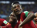 Asamoah Gyan of Ghana celebrates scoring his team's second goal with teammates during the 2014 FIFA World Cup Brazil Group G match between Germany and Ghana (2-2) at Castelao on June 21, 2014 in Fortaleza, Brazil.  (Photo by Laurence Griffiths/Getty Images)