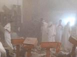 This image provided by Kuwaitna news shows the immediate aftermath of a deadly blast at a Shiite mouse in Kuwait City, Friday, June 26, 2015. A posting on a Twitter account known to belong to the Islamic State group claimed that the explosion was work of a suicide bomber wearing an explosive belt. (Kuwaitna News via AP)