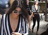 26.JUNE.2015 - PARIS - FRANCE\n*** AVAILABLE FOR UK SALE ONLY ***\nKENDAL JENNER SEEN LEAVING THE FASHION AVENUE RESTAURANT IN PARIS LOOKING VERY FASHIONABLE IN A PAIR OF SKINNY JEANS. KENDALL ALSO WORE A VERY REVEALING LOW CUT V NECK TOP. \nBYLINE MUST READ : E-PRESS/XPOSUREPHOTOS.COM\n***UK CLIENTS - PICTURES CONTAINING CHILDREN PLEASE PIXELATE FACE PRIOR TO PUBLICATION ***\n**UK CLIENTS MUST CALL PRIOR TO TV OR ONLINE USAGE PLEASE TELEPHONE 0208 344 2007**