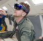 NASA and Microsoft engineers test Project Sidekick on NASA?s Weightless Wonder C9 jet. Project Sidekick will use Microsoft HoloLens to provide virtual aid to astronauts working on the International Space Station    PHOTO DATE: 05-06-15\nLOCATION: Ellington Field - NASA C-9 Aircraft\nSUBJECT: Reduced Gravity Office's JPL research flights. Flight 3\nPHOTOGRAPHER(S): BILL STAFFORD