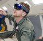 NASA and Microsoft engineers test Project Sidekick on NASA?s Weightless Wonder C9 jet. Project Sidekick will use Microsoft HoloLens to provide virtual aid to astronauts working on the International Space Station    PHOTO DATE: 05-06-15\nLOCATION: Ellington Field - NASA C-9 Aircraft\nSUBJECT: Reduced Gravity Office's JPL research flights. Flight 3\nPHOTOGRAPHER(S): BILL STAFFORD
