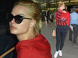 EXCLUSIVE: A tired looking Margot Robbie arrives in the UK after her flight from Toronto was delayed for 11 hours.  Pictured: Margot Robbie Ref: SPL1063079  260615   EXCLUSIVE Picture by: London Ent/Splash News  Splash News and Pictures Los Angeles: 310-821-2666 New York: 212-619-2666 London: 870-934-2666 photodesk@splashnews.com