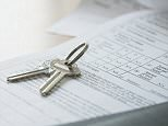 House keys on mortgage document.   Image by Kate Kunz/Corbis.