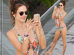 UK CLIENTS MUST CREDIT: AKM-GSI ONLY EXCLUSIVE: Alessandra Ambrosio once again today enjoyed the sunny Rio De Janeiro weather with her pretty friend by the Fasano Hotel pool, sporting a colored patterned one piece, Ambrosio took a bunch of selfies and enjoyed the view of the ocean front hotel.  Pictured: Alessandra Ambrosio Ref: SPL1063385  250615   EXCLUSIVE Picture by: AKM-GSI / Splash News