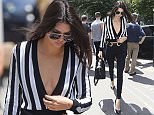 Kendall Jenner at her hotel during men's fashion week in Paris. 26/06/2015. Paris, France.  Pictured: Kendall Jenner Ref: SPL1063555  260615   Picture by: KCS Presse / Splash News  Splash News and Pictures Los Angeles: 310-821-2666 New York: 212-619-2666 London: 870-934-2666 photodesk@splashnews.com