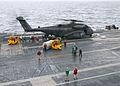 US Navy 021217-N-4953E-002 Sailors aboard the Harry S. Truman offload a jet engine from a CH-53 Sea Stallion helicopter assigned to Helicopter Combat Support Squadron Four Two (HC-42).jpg
