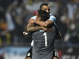 Argentina's forward Carlos Tevez (top) celebrates with goalkeeper Sergio Romero after scoring his shot in the penalty shoot-out to defeat Colombia 5-4 in their 2015 Copa America football championship quarter-final match, in ViÒa del Mar, Chile, on June 26, 2015.     AFP PHOTO / JUAN BARRETOJUAN BARRETO/AFP/Getty Images