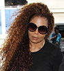 Rare sighting: Janet Jackson spotted at LAX airport wearing a camouflage leather jacket on Tuesday evening