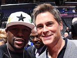 LOS ANGELES, CA - FEBRUARY 23: Boxer Floydd Mayweather and actor Rob Lowe shake hands during a game between the Memphis Grizzlies and Los Angeles Clippers on February 23, 2015 at STAPLES Center in Los Angeles, California. NOTE TO USER: User expressly acknowledges and agrees that, by downloading and/or using this photograph, User is consenting to the terms and conditions of the Getty Images License Agreement. Mandatory Copyright Notice: Copyright 2015 NBAE (Photo byAndrew Bernstein./NBAE via Getty Images)