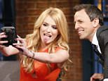 LATE NIGHT WITH SETH MEYERS -- Episode 227 -- Pictured: (l-r) Actress/model Bella Thorne during an interview with host Seth Meyers on June 25, 2015 -- (Photo by: Lloyd Bishop/NBC/NBCU Photo Bank via Getty Images)