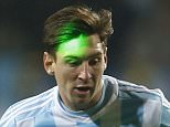 A laser reflects on Argentina's Lionel Messi as he plays the ball during a Copa America quarterfinal soccer match against Colombia at the Sausalito Stadium in Vina del Mar, Chile, Friday, June 26, 2015. (AP Photo/Andre Penner)