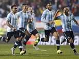 Argentina's players celebrate after Carlos Tevez scored the winning penalty kick  during a Copa America quarterfinal soccer match against Colombia  at the Sausalito Stadium in Vina del Mar, Chile, Friday, June 26, 2015. (AP Photo/Andre Penner)
