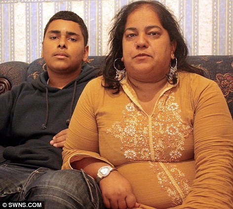 Fearless: Iftikhar Ahmed fought off a baying mob of rioters to rescue his mother Rashida after she was battered by 12 yobs