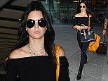 27 June 2015. Kendall Jenner seen arriving at London Heathrow airport this morning after flying in from Paris.  Credit: Ben Eade/GoffPhotos.com   Ref: KGC-102
