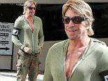 Beverly Hills, CA - Mickey Rourke stops by the hair salon ahead of the weekend in Beverly Hills. The actor got into the passenger side of his car in camo cargo pants, a green hoody with sneakers and shades with a fresh cut.\nAKM-GSI    June  26, 2015\nTo License These Photos, Please Contact :\nSteve Ginsburg\n(310) 505-8447\n(323) 423-9397\nsteve@akmgsi.com\nsales@akmgsi.com\nor\nMaria Buda\n(917) 242-1505\nmbuda@akmgsi.com\nginsburgspalyinc@gmail.com