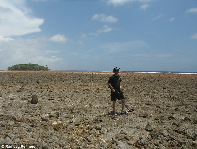 Off course: Dick Spink (pictured on the island) and Les Kinney hope are hoping to conclusively prove the Mili atoll was where the plane came down after finding a piece of metal which could have been on the aircraft