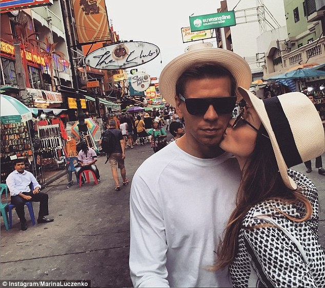 Poland international Szczesny poses for a picture with his girlfriendduring his break in Thailand