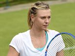 epa04822430 Maria Sharapova of Russia arrives for a training session on the eve of the Wimbledon Championships at the All England Lawn Tennis Club, in London, Britain, 28 June 2015.  EPA/FACUNDO ARRIZABALAGA