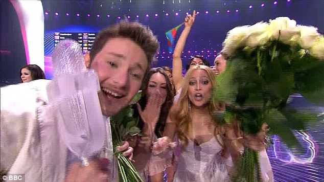 Winners: Azerbaijan's Ell and Nikki with the Eurovision Song Contest trophy and a large bunch of flowers