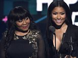 Carol Maraj, left, looks on as Nicki Minaj accepts the award for best female hip hop artist at the BET Awards at the Microsoft Theater on Sunday, June 28, 2015, in Los Angeles. (Photo by Chris Pizzello/Invision/AP)