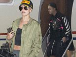 Justin Bieber disembarks in Sydney with his entourage to visit Hailey Baldwin.\n\nPictured: Justin Bieber\nRef: SPL1065931  280615  \nPicture by: Splash News\n\nSplash News and Pictures\nLos Angeles: 310-821-2666\nNew York: 212-619-2666\nLondon: 870-934-2666\nphotodesk@splashnews.com\n