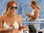 28.JUNE.2015 - CAPRI - ITALY\n* EXCLUSIVE ALL ROUND PICTURES AVAILABLE FOR UK USA GERMANY AND AUSTRALIA ONLY *\nAMERICAN ACTRESS LINDSAY LOHAN IS SEEN SMOKING A CIGARETTE WHILE HOLIDAYING ON A YACHT IN CAPRI, ITALY.\nBYLINE MUST READ : XPOSUREPHOTOS.COM\n***UK CLIENTS - PICTURES CONTAINING CHILDREN PLEASE PIXELATE FACE PRIOR TO PUBLICATION ***\n**UK CLIENTS MUST CALL PRIOR TO TV OR ONLINE USAGE PLEASE TELEPHONE 44 208 370 0291**