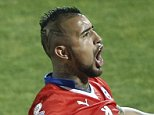 Chile's Arturo Vidal, right, reacts after his teammate Mauricio Isla scored against Uruguay during a Copa America quarterfinal soccer match at the National Stadium in Santiago, Chile, Wednesday, June 24, 2015. (AP Photo/Silvia Izquierdo)