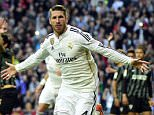 Real Madrid's defender Sergio Ramos celebrates after scoring during the Spanish league football match Real Madrid CF vs Malaga FC at the Santiago Bernabeu stadium in Madrid on April 18, 2015.   AFP PHOTO/ GERARD JULIEN        (Photo credit should read GERARD JULIEN/AFP/Getty Images)