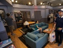 """Visitors tour Hulu's """"Seinfeld: The Apartment"""", a temporary exhibit displaying a replica set and original items from the """"Seinfeld"""" televison series in New York"""