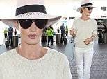 June 12, 2015:  Rosie Huntington-Whiteley looking chic in all white at LAX Airport, Los Angeles. CA.\nMandatory Credit: INFphoto.com Ref.: infusla-305
