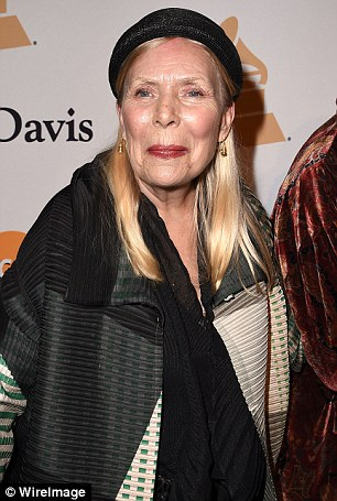 Legendary folk singer Joni Mitchell (pictured in February) is 'alert' and fully responsive in hospital, her representatives have announced