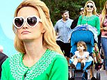 EXCLUSIVE: Holly Madison and husband Pasquale Rotella were spotted spending the day at Disneyland with daughter Rainbow Aurora in Anaheim, CA over the weekend. The family were seen taking a ride on 'It's A Small World', Haunted Mansion, Pirates Of The Caribbean, and The Jungle Cruise.  Pictured: Holly Madison, Pasquale Rotella, Rainbow Aurora Rotella Ref: SPL1066615  290615   EXCLUSIVE Picture by: Sharpshooter Images / Splash   Splash News and Pictures Los Angeles: 310-821-2666 New York: 212-619-2666 London: 870-934-2666 photodesk@splashnews.com