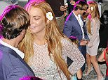 29.JUNE.2015 - CAPRI - ITALY  * EXCLUSIVE ALL ROUND PICTURES AVAILABLE FOR UK USA GERMANY AND AUSTRALIA ONLY * AMERICAN ACTRESS LINDSAY LOHAN IS SEEN GETTING CLOSE TO ITALIAN MODEL MASSIMILIANO NERI AS THE PAIR ARE SEEN DANCING, HOLDING HANDS AND LAUGHING TOGETHER ON THE DANCEFLOOR AT A BAR IN CAPRI, ITALY. LINDSAY WORE A NUDE COLOURED DRESS WITH FLOWERS, SPARKLY HEELS AND A WHITE FLOWER IN HER HAIR. BYLINE MUST READ : XPOSUREPHOTOS.COM ***UK CLIENTS - PICTURES CONTAINING CHILDREN PLEASE PIXELATE FACE PRIOR TO PUBLICATION *** **UK CLIENTS MUST CALL PRIOR TO TV OR ONLINE USAGE PLEASE TELEPHONE 44 208 370 0291**