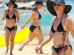 *PREMIUM EXCLUSIVE* **NO WEB, MUST CALL FOR PRICING** Honolulu, HI - Jennie Garth enjoys a family getaway in Honolulu, Hawaii with her fiancee David Abrams and her three daughters Fiona, Luca and Lola Facinelli. The former 90210 star played in the sun with her family in a black two piece bikini while putting her large rose tattoo on display.\n**MANDATORY CREDIT MUST READ: FameFlynet/AKM-GSI**\nAKM-GSI         June  27, 2015\nTo License These Photos, Please Contact :\n Steve Ginsburg\n (310) 505-8447\n (323) 423-9397\n steve@akmgsi.com\n sales@akmgsi.com\n \n or\n \n Maria Buda\n (917) 242-1505\n mbuda@akmgsi.com\n ginsburgspalyinc@gmail.com