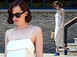 Picture Shows: Dakota Johnson  June 30, 2015\n \n \n Dakota Johnson spotted out and about in Barcelona, Spain. Dakota wore a simple, cream shift dress which showed off her shoulder tattoo while out enjoying the sun.\n \n Non Exclusive\n UK, USA AND AUSTRALIA RIGHTS ONLY\n \n Pictures by : FameFlynet UK © 2015\n Tel : +44 (0)20 3551 5049\n Email : info@fameflynet.uk.com