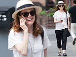 EXCLUSIVE: Julianne Moore seen chatting on her phone while walking home in the West Village in New York City.  Pictured: Julianne Moore Ref: SPL1064517  010715   EXCLUSIVE Picture by: BLT / Splash News  Splash News and Pictures Los Angeles: 310-821-2666 New York: 212-619-2666 London: 870-934-2666 photodesk@splashnews.com