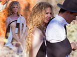 NICOLE KIDMAN POSES FOR A PHOTO SHOOT AT ULURU.\nNICOLE WAS PHOTOGRAPHED FOR AUSTRALIAN VOGUE MAGAZINE AT AUSTRALIA'S RED CENTRE. \nTHE FAMOUS AUSSIE ACTRESS DITCHED HER FAMOUS RED HAIR AT THE RED CENTRE. INSTEAD HAVING A MORE BLONDE CURLY DO, WITH HAIR EXTENSIONS.\nNICOLE WAS SPOTTED ENJOYING A CHAT WITH FASHION PHOTOGRAPHER WILL DAVIDSON AS SHE LEFT THE SET.\nVOGUE FASHION DIRECTOR CHRISTINE CENTENERA WAS ON HAND TO ENSURE A SUCCESSFUL SHOOT\nEXCLUSIVE\n©MEDIA-MODE.COM