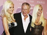 LOS ANGELES - AUGUST 18:  Playboy founder Hugh Hefner and his dates, Holly Madison (L) and Kendra Wilkinson (R) arrive at Paris Hilton's debut cd release party at Privlage on August 18, 2006 in Los Angeles, California. (Photo by Kevin Winter/Getty Images)