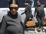 Van Nuys, CA - Pregnant Kim Kardashian arrives at the studio in Van Nuys to handle some business in the valley with family. Kim wore her usual black pregnancy outfit, a black sweater with black spandex, sneakers and an extra long shirt with shades as she headed indoors on a hot day in L.A.\nAKM-GSI        July  3, 2015\nTo License These Photos, Please Contact :\nSteve Ginsburg\n(310) 505-8447\n(323) 423-9397\nsteve@akmgsi.com\nsales@akmgsi.com\nor\nMaria Buda\n(917) 242-1505\nmbuda@akmgsi.com\nginsburgspalyinc@gmail.com