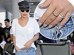 Picture Shows: Rita Ora  July 02, 2015\n \n British singer Rita Ora departs on a flight from LAX airport in Los Angeles, California. The singer was keeping things casual on her journey, rocking a white t-shirt, white sneakers, and blue jeans. \n \n Non Exclusive\n UK RIGHTS ONLY\n \n Pictures by : FameFlynet UK © 2015\n Tel : +44 (0)20 3551 5049\n Email : info@fameflynet.uk.com