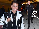 Ruby Rose was spotted landing at NYC's JFK airport on Friday evening, as she prepares to DJ a huge Fourth of July party in NYC. After a long flight, she still looked perfect, with her hair slicked back, and a big smile on her face. She wore a white leather jacket as she strolled through the terminal, and later took the jacket off, revealing a casual black button up shirt.....Pictured: Ruby Rose..Ref: SPL1069861  030715  ..Picture by: 247PAPS.TV / Splash News....Splash News and Pictures..Los Angeles: 310-821-2666..New York: 212-619-2666..London: 870-934-2666..photodesk@splashnews.com..
