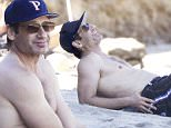 139530, EXCLUSIVE: David Duchovny enjoying a day at the beach with friends in Malibu. He walked off the beach with quit a limp. Malibu, California - Thursday July 2, 2015. Photograph: © Sage/Fritz, PacificCoastNews. Los Angeles Office: +1 310.822.0419 sales@pacificcoastnews.com FEE MUST BE AGREED PRIOR TO USAGE