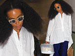 UK CLIENTS MUST CREDIT: AKM-GSI ONLY\nEXCLUSIVE: Solange Knowles heads out of Los Angeles with a home-made cake at LAX. The singer, songwriter, model, actress and younger sister to Beyoncøkept her head down in front of the cameras as she walked to her departure gate with a home-made cake in her hand.\n\nPictured: Solange Knowles\nRef: SPL1070549  030715   EXCLUSIVE\nPicture by: AKM-GSI / Splash News\n\n