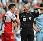Marching orders: Referee Mike Dean shows Barton a straight red card