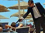 Staff at the Domina Hotel Complex Coral Bay in Egypt holding an imitation gun to holidaymakers' heads, just a week after Tunisia terror attack