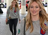 """July 03, 2015\n \n """"Younger"""" star Hilary Duff arrives at LAX airport to catch a flight out of town in Los Angeles, California. Hilary was dressed casually for her flight in a grey sweater, black jeans and converse sneakers.\n \n Non-Exclusive\n UK RIGHTS ONLY\n \n Pictures by : FameFlynet UK © 2015\n Tel : +44 (0)20 3551 5049\n Email : info@fameflynet.uk.com"""