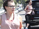 """Picture Shows: Milla Jovovich  July 03, 2015\n \n """"Resident Evil"""" star Milla Jovovich runs to the gym for a workout in Los Angeles, California. Milla has quickly gotten her body back into amazing form after having given birth just three months ago! \n \n Exclusive All Rounder\n UK RIGHTS ONLY\n FameFlynet UK © 2015\n Tel : +44 (0)20 3551 5049\n Email : info@fameflynet.uk.com"""